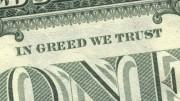 """Primer plano de billete de un dolar con la leyenda """"in greed we trust"""""""