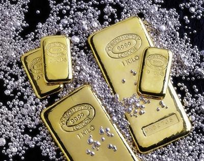 Lingotes de oro y pepitas de plata