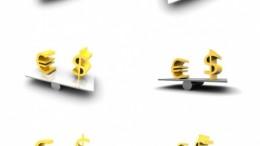 Símbolos del dólar y euro en balanza