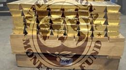 Lingotes de oro con logo FMI