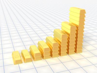 Lingotes de oro apilados subiendo