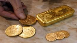 Monedas y lingote oro