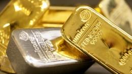 Lingotes oro y lingote plata