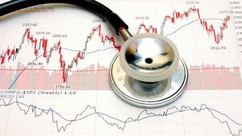 Gráficas financieras con fonendoscopio