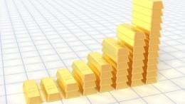 Lingotes de oro con forma de grafica creciente precio oro