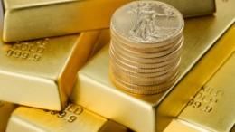 Lingotes oro y American Gold Eagle