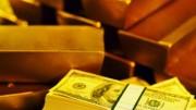 Lingotes de oro y fajo de billetes de dolar