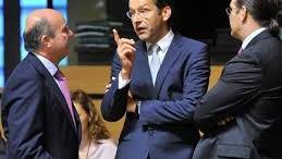Luis de Guindos y Jeroen Dijsselbloem en el Ecofin