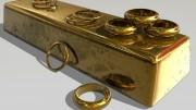Anillos de oro sobre lingote de oro