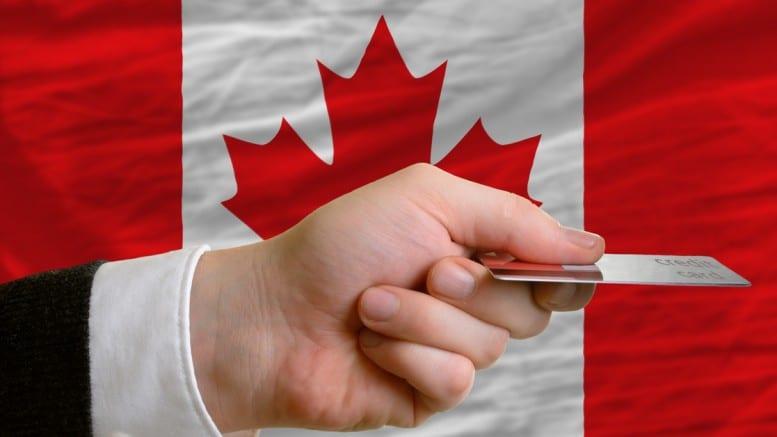 Bandera de Canada pagando con mano pagando con tarjeta