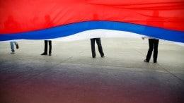 Bandera Rusia con personas