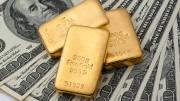 Dólares y lingotes de oro