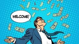 Lluvia de dinero cayendo sobre una persona
